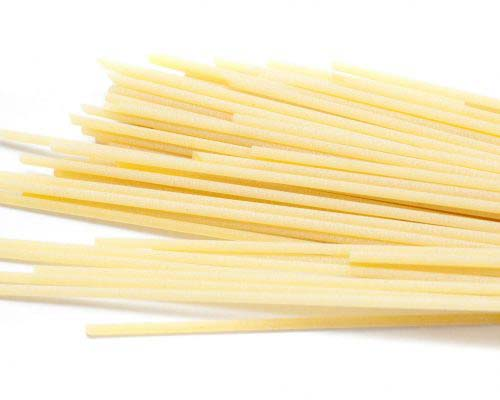 Uncooked Italian spaghetti pasta made from healthy durum wheat and used as an ingredient in Mediterranean cuisine